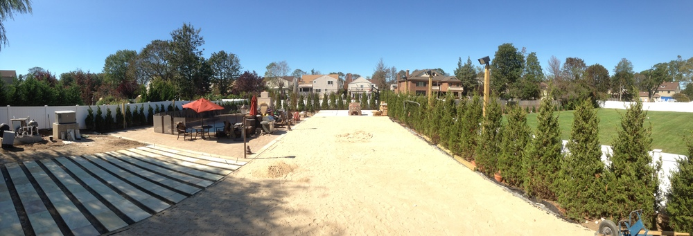 Stone walkway to pool terrace + level area to prepare for soccer field.