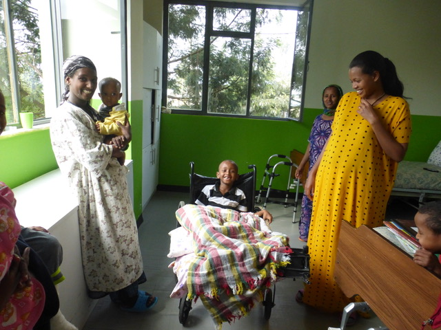 We found smiles everywhere. This photo was taken at the newly opened rehabilitation center at the hospital.