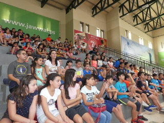 The closing ceremony for the sports camp at the Catholic Action Center.