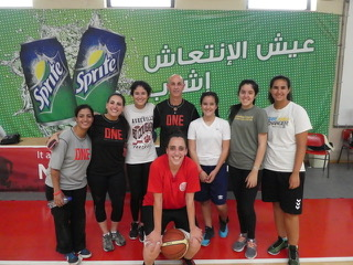 """The team of """"locals"""" who assisted in translation and coaching stand with Dennis Dye, the director of this sports camp."""