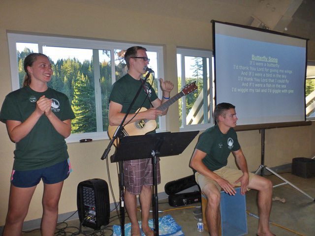 "Claire, Robert, and Jacob lead ""The Butterfly Song."""