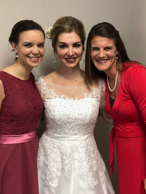 Katie Grieb and Lisa Friesen support Elsa on her special day.