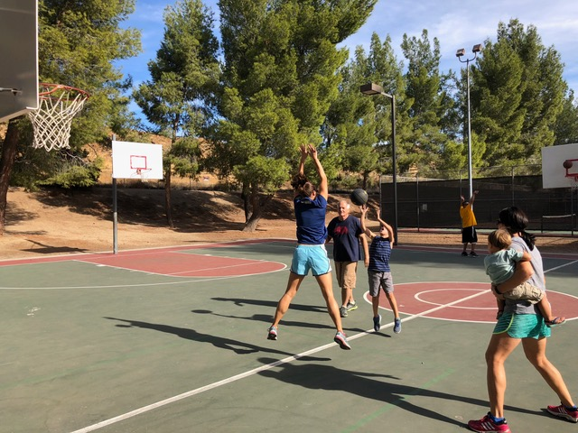 Serious basketball at the park before the Thanksgiving feast.