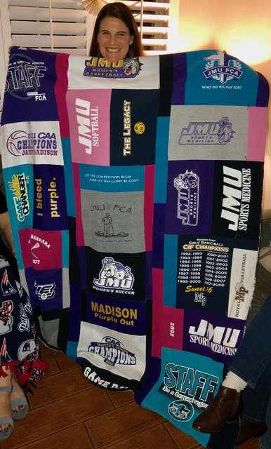 She loved her t-shirt quilt (and BTW, this is the first of several, as I used only a small portion of the t-shirts she has!).