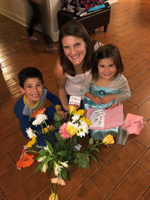 "The beautiful bouquet takes center stage as Ana and Brandon give Auntie Lisa their card filled with homemade ""gift certificates"" (redeemable for foot rubs, ""servant for a day"", etc.)"