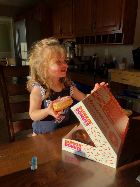 Rachel's love for pink frosted donuts is met when Uncle David and Aunt Laura arrived on moving day to support the effort.