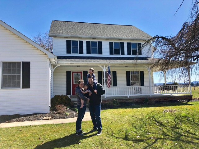 The final Johnson family photo in front of their first owned home.