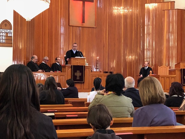 Badveli Raffi welcomes the congregation to his church on Martyr's Day in recognition of the Armenian genocide.