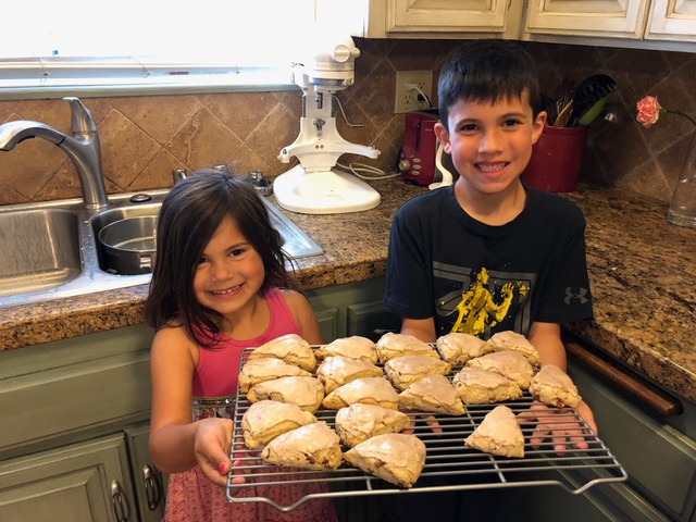 "Brandon and Ana are expert helpers in the kitchen and proudly present a batch of freshly baked cinnamon chip scones, aka ""Gigi Cakes"""