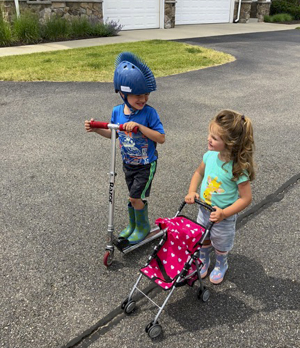 These two LOVE to be outside, and though Rachel doesn't have her baby in the stroller, she does have rocks in the back pocket of it.  :)