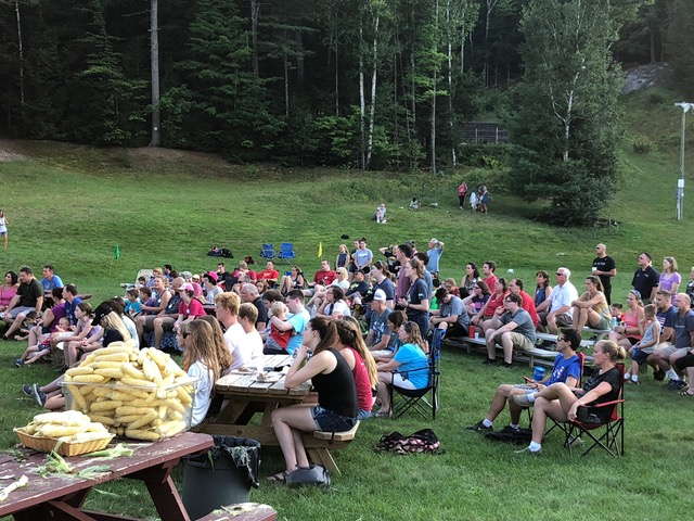 Outdoor worship, family games, and shucking the corn for the Corn Roast . . . mixing new and old traditions!