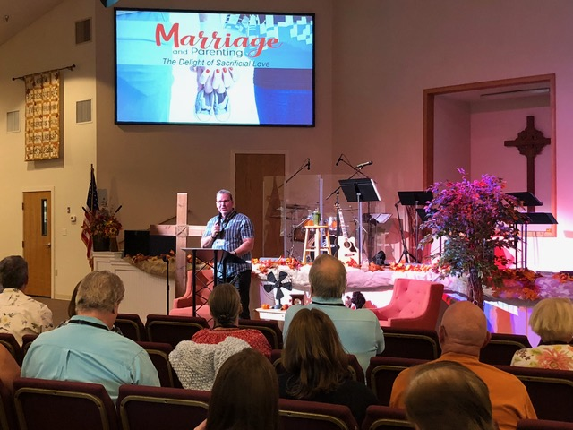 Kent Copley opens the marriage conference with a welcome.