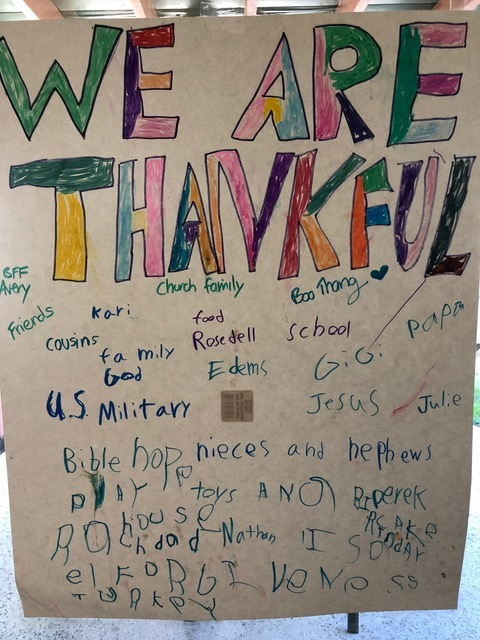 Focusing on giving thanks, everyone contributed their thoughts to the poster designed by Brandon.