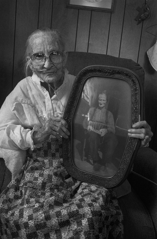 Dellie Holding a Photograph of Her Father, Mart Chandler