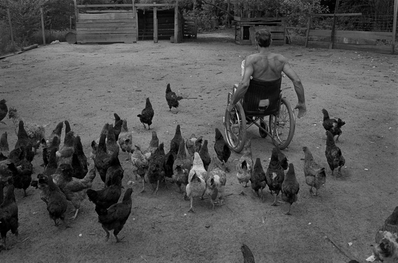 Bunky Feeding His Chickens, Brunswick County, NC