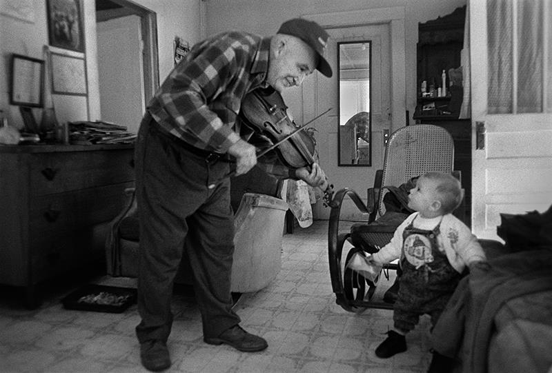 Doug Playing Fiddle for Kate, Crain Branch, Madison County, North Carolina, 1992