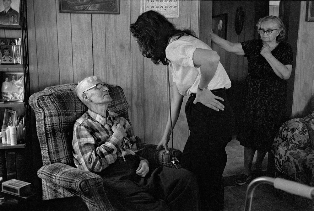 Home Health Nurse Susan Moore with 97-year old George Roberts and his daughter, Gertie Randall, Big Pine, Madison County, NC, 1984.