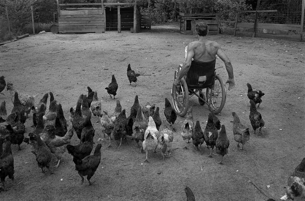 Bunky Feeding His Chickens, Brunswick County, NC 1987 - for Rural Advancement Fund