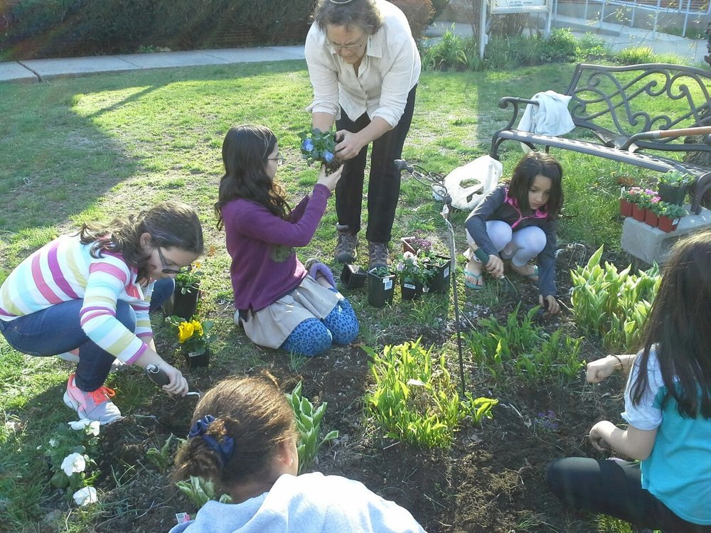 electives april tracy with girls planting.jpg