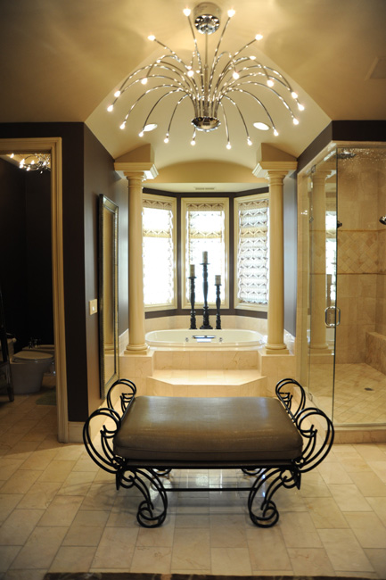 A contemporary chandelier adds a great amount of style to this fabulous Master Bath.