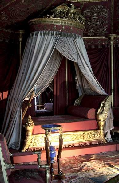 Josephine Boneparte's bedroom, Château de Malmaison. She is well-known for her love of the swan motif, seen here on this famous bed.