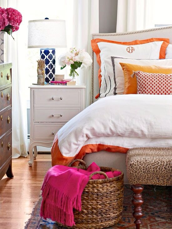 Don't ignore the room in which you slumber. A colorful throw, fresh bedding, a fun lamp and gorgeous flowers all contribute to alleviating the heaviness of dark woods, rugs and upholstery.