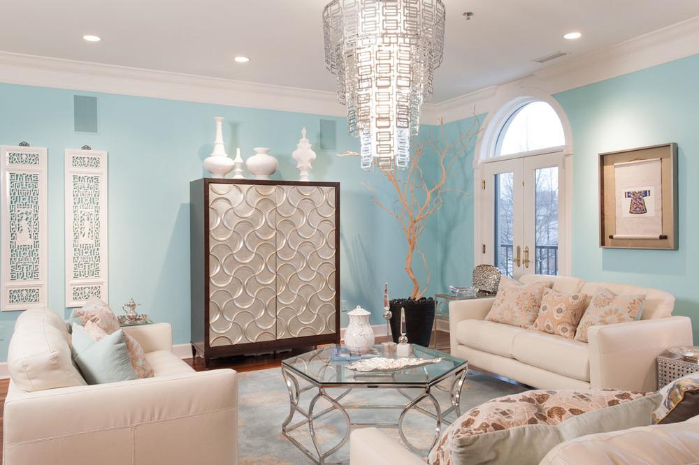 "Soft blue walls (reminiscent of that famous Tiffany box), creamy upholstery, and silvery accents make this living room by Savvy's Kimberly Kowalski a breath of fresh air. Wall Color: Sherwin Williams 6765 ""Spa""   PHOTO BY ANNE MATHEIS"