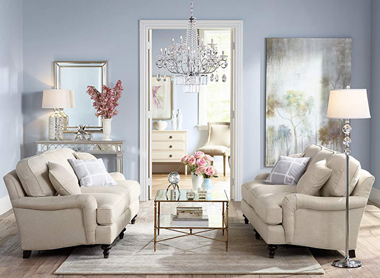 Image: Traditional Home  Soft blue walls wrap this room in comfort, with subtle pops of pink in the floral arrangements.