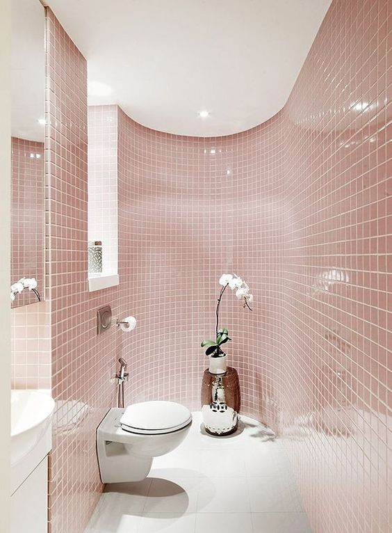 Image: DecorSalteado   Stunning use of Rose Quartz tile! This bathroom literally wraps you in the Color of the Year.