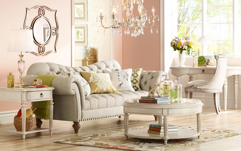 Image: LampsPlus   This very feminine interpretation of a room done in pink receives layers of sophistication with traditional furnishings in a gorgeous griege color way.