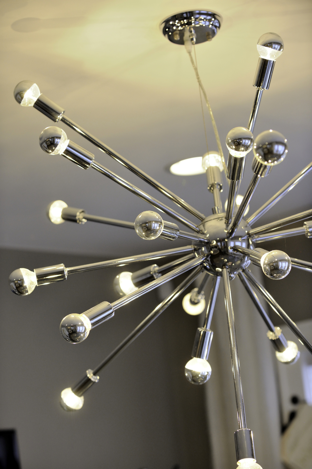 A closeup of the gorgeous contemporary chandelier above the conference table.