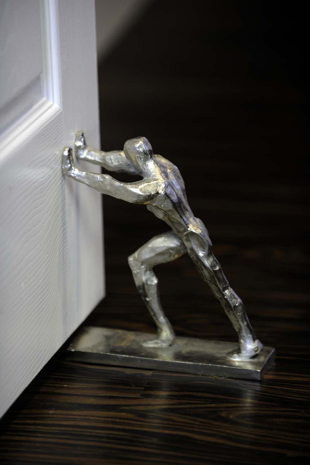 Whimsical details, such as this fun doorstop, are found throughout Kate & Co.