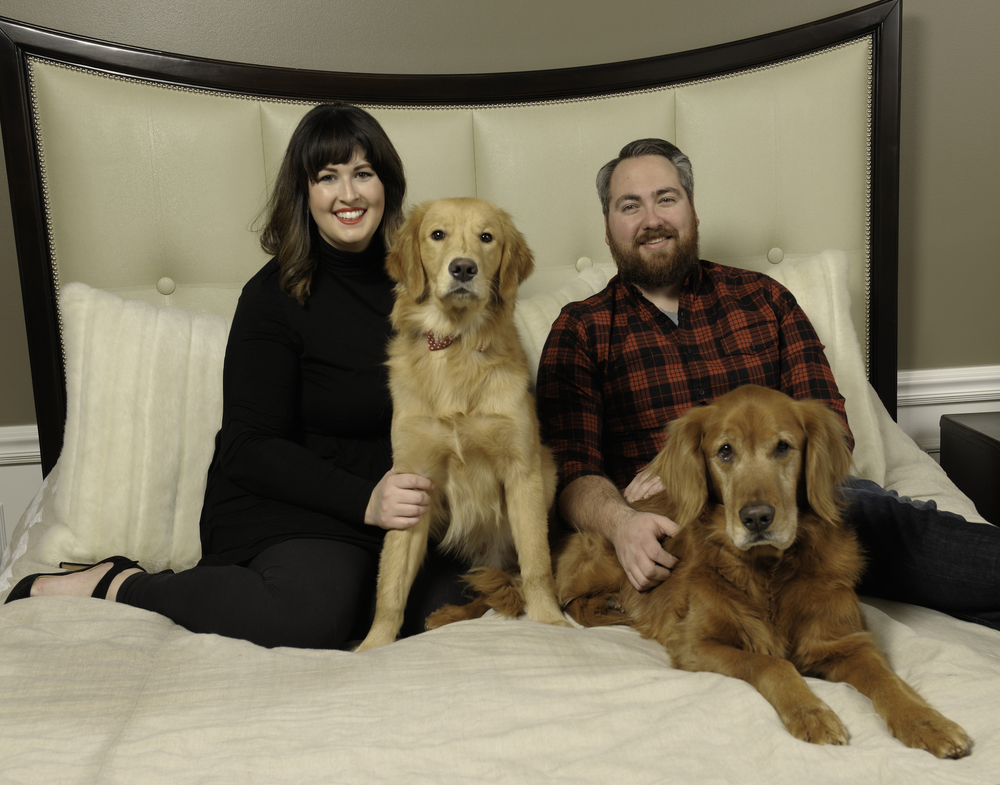 Kate and Adam Turner and their two golden retrievers, Louis and Carlton.