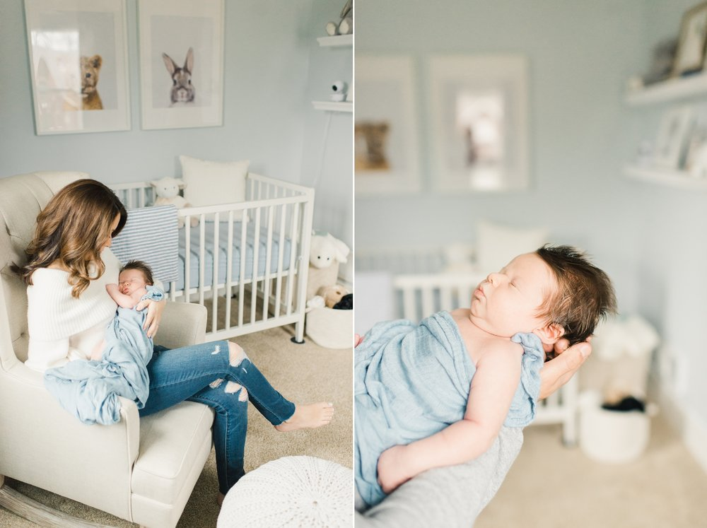 mother and newborn boy in blue and white nursery