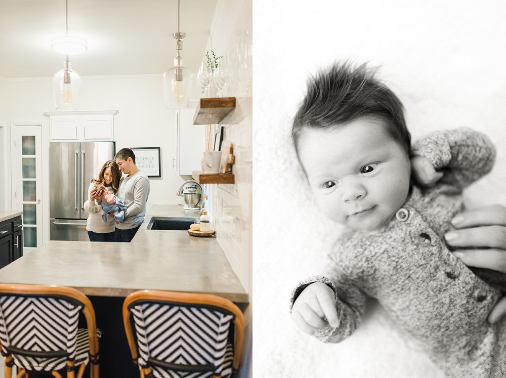 parents with newborn in remodeled, modern kitchen