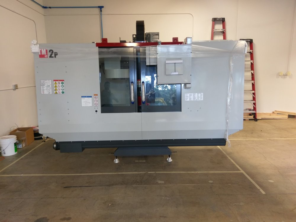 "Our new HAAS CNC machine is ""sitting pretty"" in our new location."