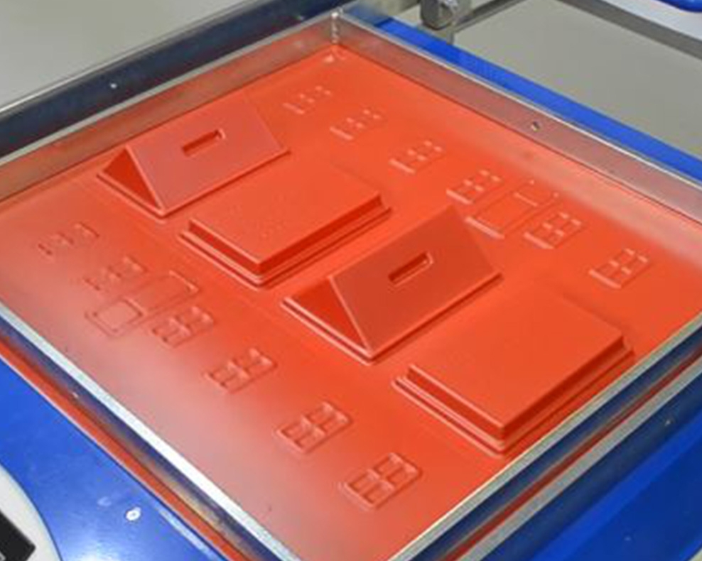 Thermoforming and vacuum forming are excellent technologies for manufacturing plastic panels, housings and displays like the one pictured above.