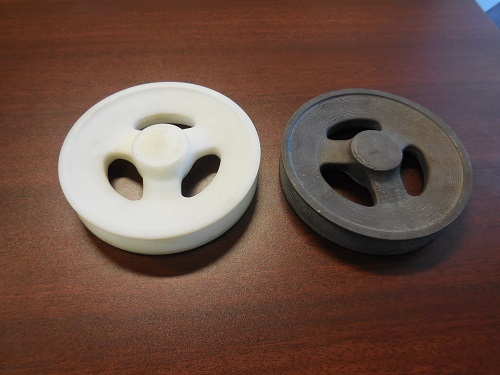Reverse engineered 3D printed replacement part for a pulley.