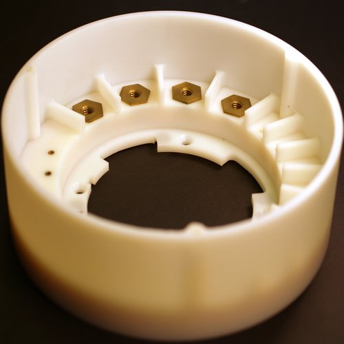 Custom plastic part machined from an acetal polymer.