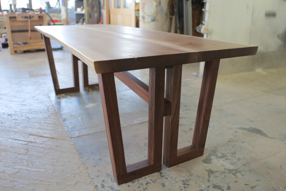 Solid walnut table with tapered legs