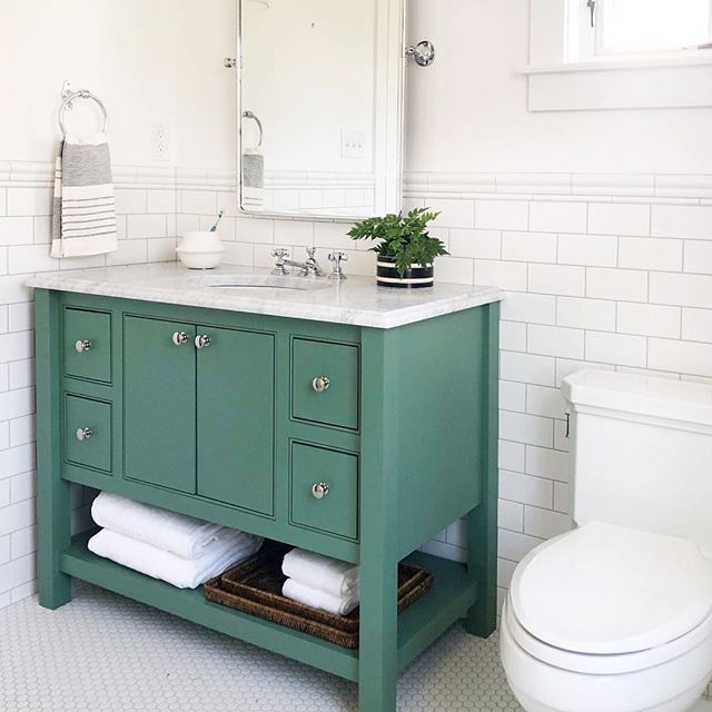 """#Repost @highstreetmarket ・・・ one of our last shots from #merionmillhouse is this cute kid's bath with a custom green vanity and polished nickel fixtures. We kept the tile design simple for this 1800's house, but took a risk with the vanity color. 💚 This is the bathroom with the vintage curved corner tub (for those asking!). Vanity is Farrow & Ball """"Breakfast Room Green."""" #highstreethomedesign @mckennabuildinggroup #warrenclaytorarchitects @village_handcrafted"""