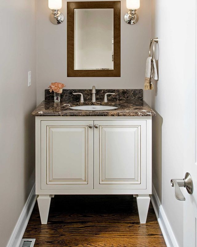 This custom vanity makes a big impact with its  legs  in a small space powder room. #powderroom #customvanity #customcabinets #designphilly #mainlinepa