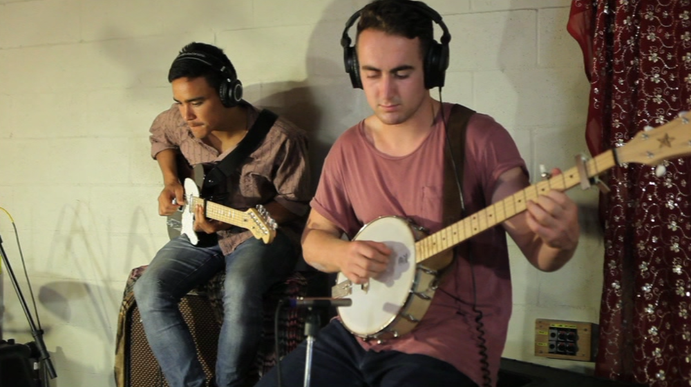 """Our banjo player Harrison Deanshaw and myself, strumming away to """"Over and over"""" by Sarah."""