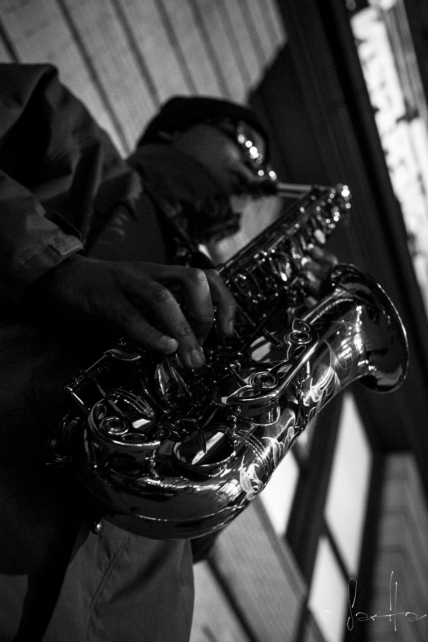 A lone saxophonist on the streets of NY played under the Marshall's sign on 18th St.