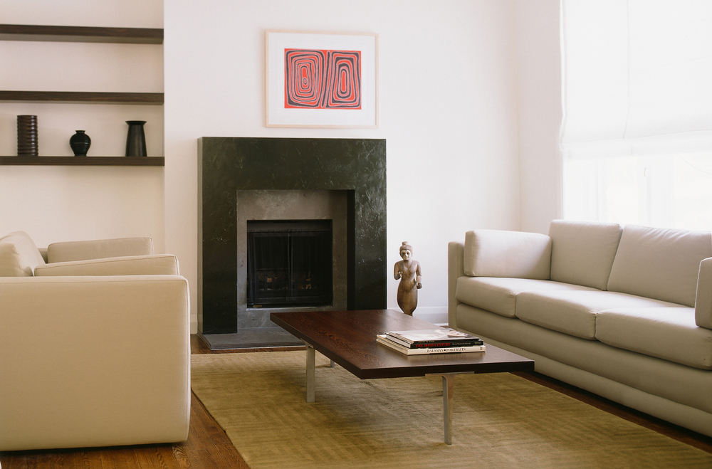 Graphic fireplace in a Minimalist modern interior.