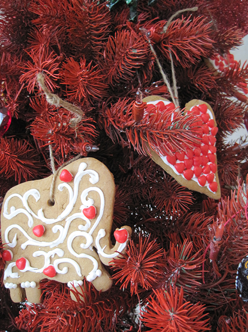 Homemade gingerbread ornaments hang from the tree.