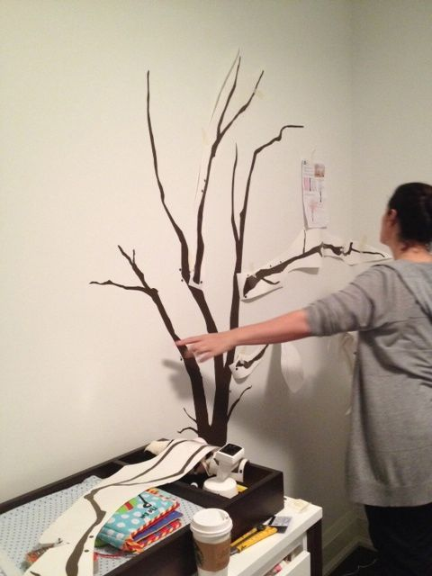 Decal Installs. As you can tell, Theresa is very hands on in everything she does from start to finish, and everything in between. This, for example, might include a decal wall installation. With the help of her intermediate designer, Kari Serrao, Theresa laid out the design of a tree decal for a client's nursery - a very detail-oriented but ultimately satisfying process.