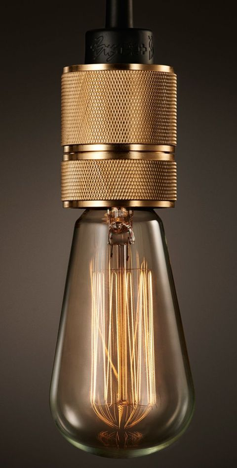 Modern brass lighting and take off on vintage version but not usually seen in brass. ( Elle Decor )