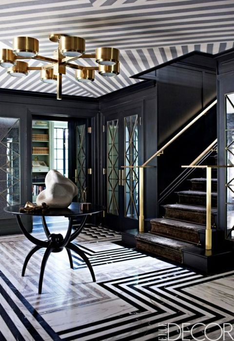 Brass railing, light fixture and hardware very sexy with graphic black and white Colour scheme. ( Elle Decor )