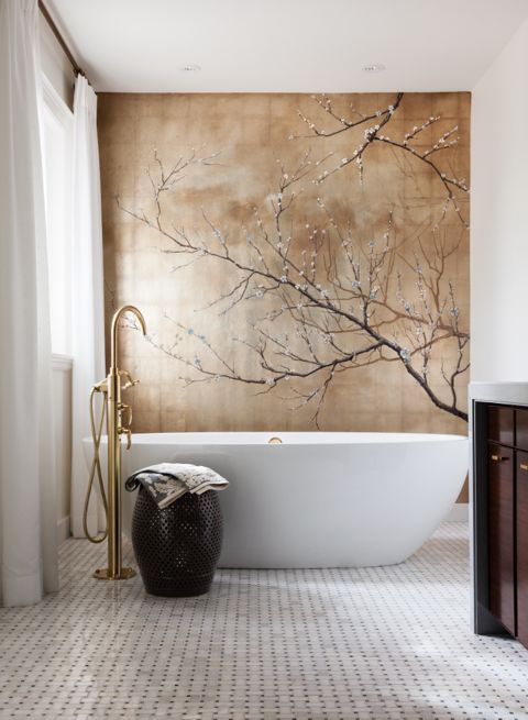 I played off the contemporary brass tub filler with an Asian inspired mural of cherry blossoms to create a zen peaceful ensuite for a young chic couple. (Casey Design/Planning Group Inc. - Photo by Donna Griffith)